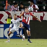 Chivas forward Alan Gordon (16) shields Revolution defender Darrius Barnes (25) during the first half of the game between Chivas USA and the New England Revolution at the Home Depot Center in Carson, CA, on September 10, 2010. Chivas USA 2, New England Revolution 0.