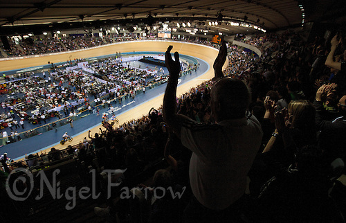 18 FEB 2012 - LONDON, GBR - Spectators watch the Men's Keirin  during the UCI Track Cycling World Cup, and London Prepares test event for the 2012 Olympic Games, in the Olympic Park Velodrome in Stratford, London, Great Britain (PHOTO (C) 2012 NIGEL FARROW)