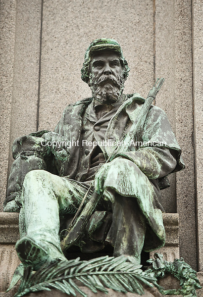 WATERBURY,  CT,  CT-041115JS80- The 48-foot tall Soldiers' Monument on the Green in Waterbury is an impressive sculpture by Civil War veteran and artist George E. Bissell. One of the four figure around the statue is this veteran sitting at a soldiers grave. <br /> Jim Shannon Republican-American