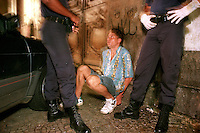 Caught in the act while officers were looking for homeless people, a car thief is detained near the object of his quest. He was trying to break in through a vent window.