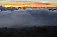 The sun sets over the fog on the Shira Plateau, on Mount Kilimanjaro.