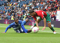 Men's Olympic Football match Honduras v Morocco on 26.7.12...Jose Velasquez of Honduras fouls Abdelaziz Barrada of Morocco, during the Honduras v Morocco Men's Olympic Football match at Hampden Park, Glasgow..........
