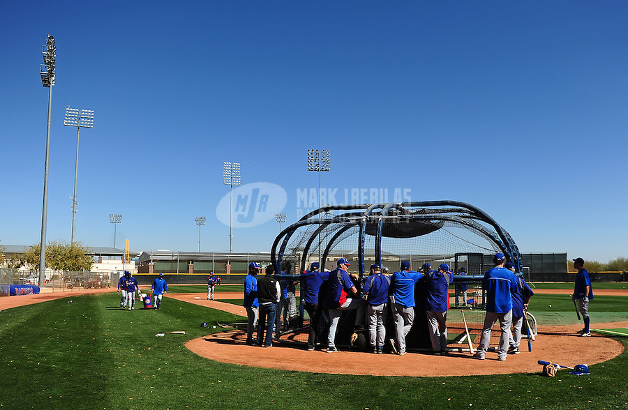 Mar. 1, 2012; Surprise, AZ, USA; Texas Rangers players surround a backstop during batting practice at spring training workouts at the practice fields at Surprise Stadium.  Mandatory Credit: Mark J. Rebilas-.