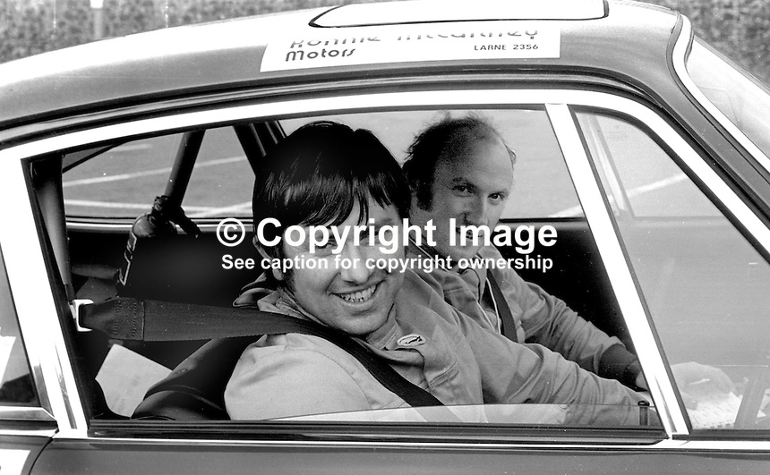 Ronnie McCartney, nearest camera, and co-driver, Ford Hutchinson, at the finish of the 1973 Circuit of Ireland, 24th April 1973, at ?????????. They were driving a Porsche 911 Carrera RS. McCartney &amp;  Hutchinson finished 3rd. 197304240217a<br /> <br /> Copyright Image from Victor Patterson, 54 Dorchester Park, Belfast, UK, BT9 6RJ<br /> <br /> t1: +44 28 9066 1296 (from Rep of Ireland 048 9066 1296)<br /> t2: +44 28 9002 2446 (from Rep of Ireland 048 9002 2446)<br /> m: +44 7802 353836<br /> <br /> e1: victorpatterson@me.com<br /> e2: victorpatterson@gmail.com<br /> <br /> The use of my copyright images is subject to my Terms &amp; Conditions.<br /> <br /> It is IMPORTANT that you familiarise yourself with them. They are available on my website at www.victorpatterson.com.<br /> <br /> None of my copyright images may be used on a website unless they are visibly watermarked, i.e. &copy; Victor Patterson within the body of the visible image. Metadata denoting my copyright must NOT be deleted. <br /> <br /> Web use (maximum size - 300 kb) is extra at currently recommended NUJ rates.