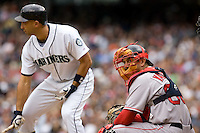 July 23, 2008: With men on base, and the Seattle Mariners' Raul Ibanez at the plate, Boston Red Sox catcher Jason Varitek looks into the dugout for defensive signs.