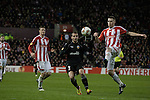 Home defender and captain Ryan Shawcross making a clearance at the Britannia Stadium, Stoke-on-Trent, during the UEFA Europa League last 32 first leg between Stoke City and visitors Valencia. The match ended in a 1-0 victory from the visitors from Spain. Mehmet Topal scored the only goal in the first half in a match watched by a crowd of 24,185.