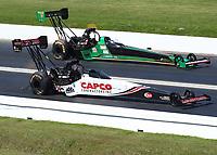 Apr 14, 2019; Baytown, TX, USA; NHRA top fuel driver Steve Torrence (near) races alongside Kebin Kinsley during the Springnationals at Houston Raceway Park. Mandatory Credit: Mark J. Rebilas-USA TODAY Sports