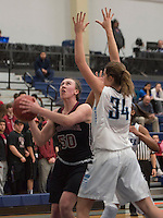 NWA Democrat-Gazette/J.T. WAMPLER  Springdale High School's Ryann Goodsell takes a shot against Har-Ber's Caroline Horner Monday Feb. 8, 2016. For a gallery of images go to http://nwamedia.photoshelter.com/