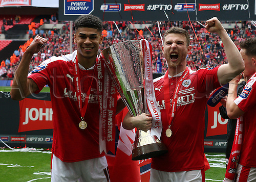 03.04.2016. Wembley Stadium,  London, England. Johnstones Paint Trophy Football Final Barnsley versus  Oxford Utd. Barnsley goal scorers Sam Winnall and Ashley Fletcher celebrate with the Trophy