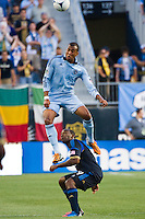 Teal Bunbury (9) of Sporting Kansas City heads the ball. Sporting Kansas City defeated the Philadelphia Union 2-0 during the semifinals of the 2012 Lamar Hunt US Open Cup at PPL Park in Chester, PA, on July 11, 2012.