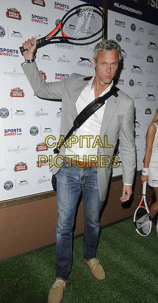 Mark Foster<br /> attended the Slazenger Wimbledon Party, Whisky Mist bar &amp; nightclub, Hertford St., London, England, UK, 27th June 2013.<br /> full length grey gray jacket jeans white shirt tennis racquet <br /> CAP/CAN<br /> &copy;Can Nguyen/Capital Pictures