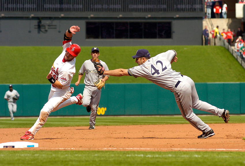 Milwaukee Brewers third baseman Tony Graffinino(R) tags out Skip Schumaker of the St. Louis Cardinals to end the seventh inning during the Cardinals 10-2 victory on Jackie Robinson Day, April 15, 2007, in St. Louis, MO.