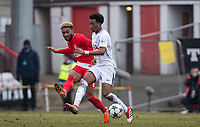 Sylla Moussa of AS Monaco FC Youth passes past Tashan Oakley-Boothe of Spurs U19 during the UEFA Youth League round of 16 match between Tottenham Hotspur U19 and Monaco at Lamex Stadium, Stevenage, England on 21 February 2018. Photo by Andy Rowland.