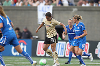 Shannon Boxx with the ball in a 2-1 FC Gold Pride win at the Boston Breakers.  Kelly Smith plays defense.
