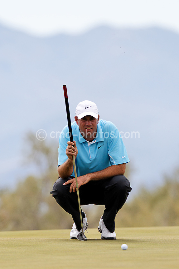 Feb 24, 2008; Marana, AZ, USA; Stewart Cink surveys a putt on the 19th hole of  his final-round match against Tiger Woods (not pictured) at the Accenture Match Play Championship at the Gallery Golf Club. Woods would go on to beat Cink 8 and 7 to earn his third victory in the WGC match play event and 15th victory overall in the World Golf Championship series.