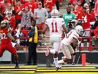 Ohio State Buckeyes cornerback Eli Apple (13) intercepts a pass in the end zone intended for Maryland Terrapins wide receiver Marcus Leak (82) behind Ohio State Buckeyes defensive back Vonn Bell (11) during the third quarter of the NCAA football game at Byrd Stadium in College Park, Maryland on Oct. 4, 2014. (Adam Cairns / The Columbus Dispatch)