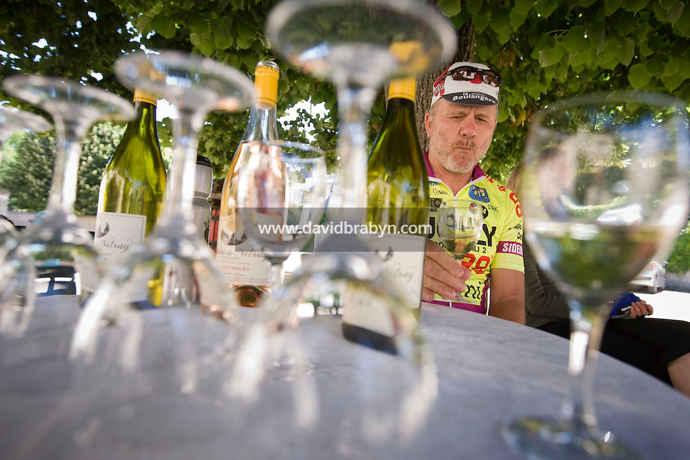 Writer David Darlington, participating in a Backroads cycle tour of the Loire Valley, tastes wine at the Chateau de Nitray in Athee-sur-Cher, France, 25 June 2008.