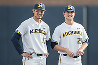 Michigan Wolverines third baseman Drew Lugbauer (17) and pitcher Mac Lozer (29) before the NCAA baseball game against the Michigan State Spartans on April 18, 2017 at Ray Fisher Stadium in Ann Arbor, Michigan. Michigan defeated Michigan State 12-4. (Andrew Woolley/Four Seam Images)