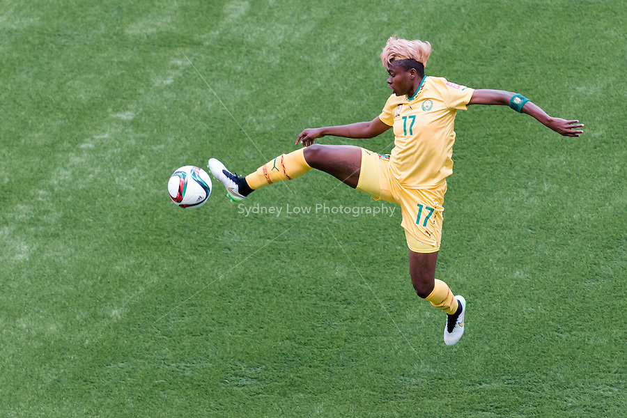 June 8, 2015: Gaelle ENGANAMOUIT of Cameroon controls the ball during a Group C match at the FIFA Women's World Cup Canada 2015 between Cameroon and Ecuador at BC Place Stadium on 8 June 2015 in Vancouver, Canada. Sydney Low/AsteriskImages