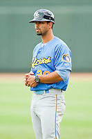 Humberto Miranda (20) of the Myrtle Beach Pelicans coaches first base during the Carolina League game against the Winston-Salem Dash at BB&T Ballpark on July 7, 2013 in Winston-Salem, North Carolina.  The Pelicans defeated the Dash 6-5 in 8 innings in game two of a double-header.  (Brian Westerholt/Four Seam Images)