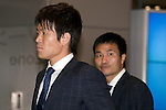 """Japan national football team, Shusaku Nishikawa, Yasuyuki Konno, June 27, 2014, Chiba, Japan - (L to R) Shusaku Nishikawa and Yasuyuki Konno arrive at Narita International Airport with other members of the Japan national football team. Members of the Japan national football team arrives at Narita with a disappointed look on their faces. They couldn't advance to the final 16 in """"2014 FIFA World Cup Brazil"""" and came back earlier. (Photo by Rodrigo Reyes Marin/AFLO)"""