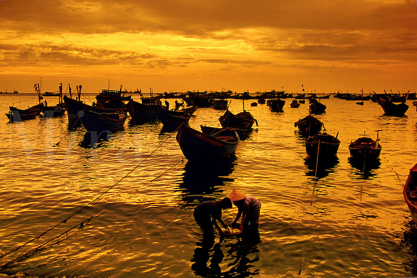 Fishing boats at sunset Vung Tau Vietnam.