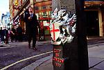 A busy sidewalk in downtown London.