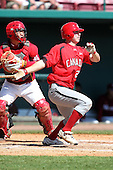 Team Canada Jerod Bartnik #25 at bat during a game vs the Nexen Heroes at Al Lang Field in St. Petersburg, Florida;  February 28, 2011.  Canada defeated Nexen 2-0.  Photo By Mike Janes/Four Seam Images