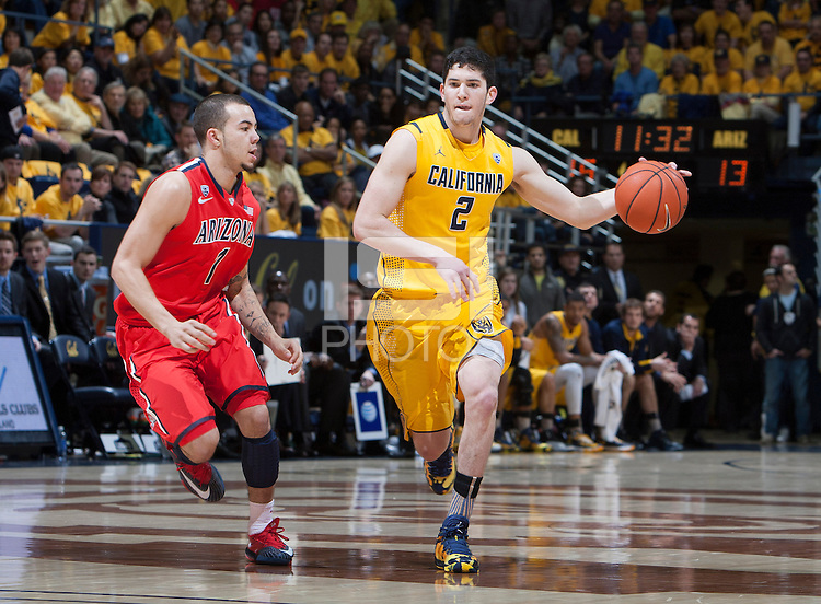 Sam Singer of California controls the ball away from Gabe York of Arizona during the game at Haas Pavilion in Berkeley, California on February 1st, 2014.  California Golden Bears defeated Arizona Wildcats, 60-58.