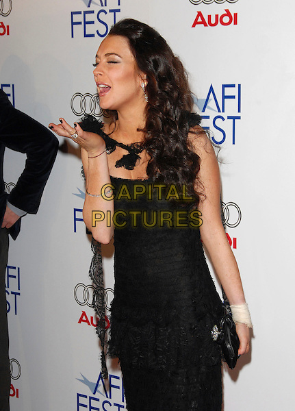 "LINDSAY LOHAN.The AFI Fest Opening Night Gala & The Weinstein Company USA Premiere of ""Bobby"" held at The Grauman's Chinese Theatre in Hollywood, California, USA..November 1st, 2006                                                             .Ref: DVS.half length dress black lace wrist bandage hand blowing kiss funny.www.capitalpictures.com.sales@capitalpictures.com.©Debbie VanStory/Capital Pictures"
