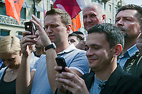 Moscow, Russia, 06/05/2012..Opposition leaders tweet on mobie phones at demonstration against Russian Presidential election results on the eve of Vladimir Putins inauguration as President.