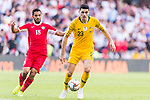 Tom Rogic of Australia (R) is followed by Mousa Mohammad Suleiman of Jordan during the AFC Asian Cup UAE 2019 Group B match between Australia (AUS) and Jordan (JOR) at Hazza Bin Zayed Stadium on 06 January 2019 in Al Ain, United Arab Emirates. Photo by Marcio Rodrigo Machado / Power Sport Images