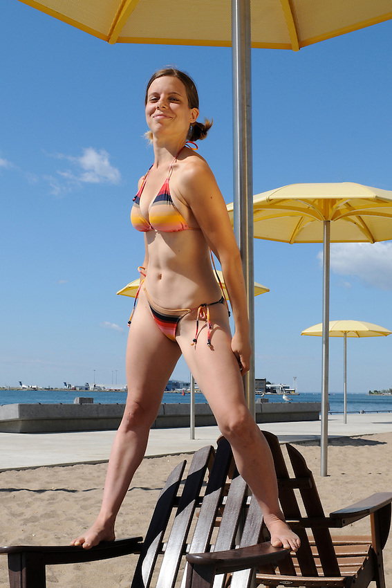 A beautiful young woman enjoying a perfect summer day at Toronto's H2O manmade beach along the Toronto Harbour waterfront