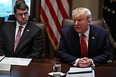 United States President Donald J. Trump speaks during a Cabinet Meeting in the Cabinet Room of the White House on November 19, 2019 in Washington, DC. At left is US Secretary of Veterans Affairs (VA) Robert Wilkie.<br /> Credit: Oliver Contreras / Pool via CNP