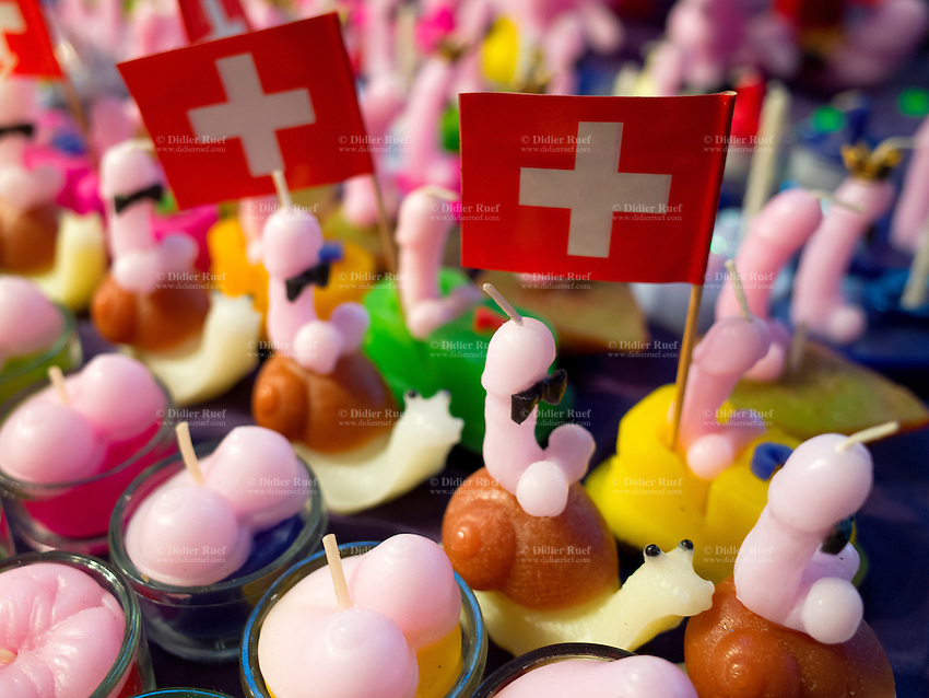 Switzerland. Canton Ticino. Lugano. Sexy candles. Penis, bosoms, swiss flags and snails. Extasia 2014 is the first erotic and sex fair in southern Switzerland. The flag of Switzerland consists of a red flag with a white cross (a bold, equilateral cross) in the centre. 1.02.14 © 2014 Didier Ruef