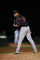 Lake Elsinore Storm relief pitcher Diomar Lopez (34) looks to his catcher for the sign during a California League game against the Rancho Cucamonga Quakes at LoanMart Field on May 19, 2018 in Rancho Cucamonga, California. Lake Elsinore defeated Rancho Cucamonga 10-7. (Zachary Lucy/Four Seam Images)