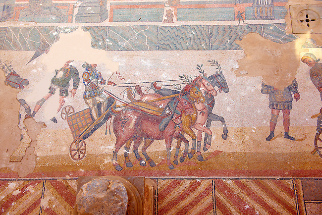 Detail of a chariotracing at the Circus Maximus Chariot racing at the Circus Maximus from the Palaestra room no 15.. Roman mosaics at the Villa Romana del Casale which containis the richest, largest and most complex collection of Roman mosaics in the world. Constructed  in the first quarter of the 4th century AD. Sicily, Italy. A UNESCO World Heritage Site.