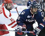 Danny O'Regan (BU - 10), Max Kalter (UConn - 18) - The Boston University Terriers defeated the visiting University of Connecticut Huskies 4-2 (EN) on Saturday, October 24, 2015, at Agganis Arena in Boston, Massachusetts.