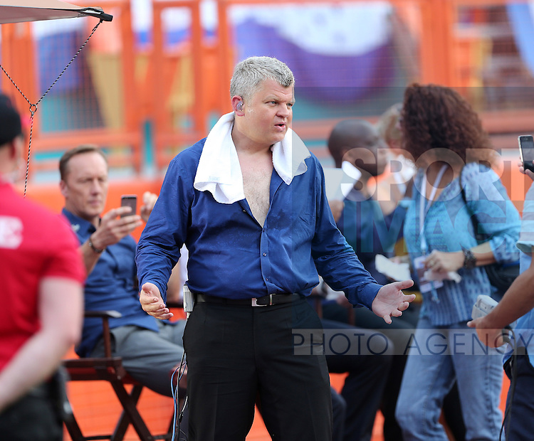 ITV's Adrian Chiles finds the going hot as he unbottons his shirt<br /> <br /> England vs Honduras  - International Friendly - Sun Life Stadium - Miami - USA - 07/06/2014  - Pic David Klein/Sportimage