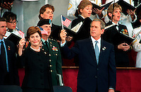 """Oct 11, 2001, Washington, DC, United States<br /> <br /> President George W. Bush (R)  and first lady Laura Bush (L)  wave the flag as the choir sings """"God Bless America"""" during a memorial service at the Pentagon on Oct. 11, 2001, in honor of those who perished in the terrorist attack on the building.  President Bush, Secretary of Defense Donald H. Rumsfeld and Chairman of the Joint Chiefs of Staff Gen. Richard B. Myers, U.S. Air Force, eulogized the 184 persons killed when a terrorist hijacked airliner was purposely crashed into the southwest face of the building on Sept. 11, 200<br /> <br /> Mandatory Credit: Photo by DoD photo by Helene C. Stikkel.(Released)-"""