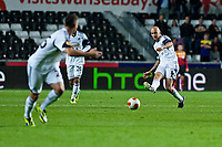 Thursday  03 October  2013  Pictured:Jonjo Shelveyof Swansea passes the ball forward Re:UEFA Europa League, Swansea City FC vs FC St.Gallen,  at the Liberty Staduim Swansea