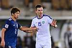 Egor Krimets of Uzbekistan (R) fights for the ball with Miura Genta of Japan (L) during the AFC Asian Cup UAE 2019 Group F match between Japan (JPN) and Uzbekistan (UZB) at Khalifa Bin Zayed Stadium on 17 January 2019 in Al Ain, United Arab Emirates. Photo by Marcio Rodrigo Machado / Power Sport Images