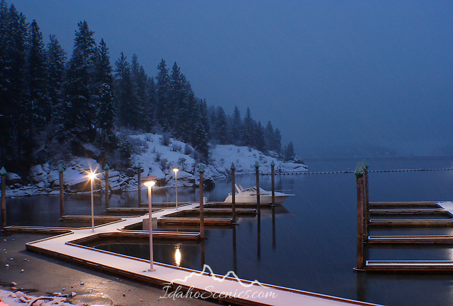 Snow covered 3rd street boat docks at dusk just after a new snowfall.