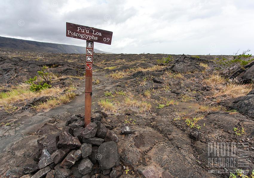 """Pu'u Loa Petroglyphs"" sign along the trail at Hawai'i Volcanoes National Park, Big Island."