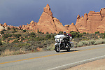 Motorcyclist along the Fiery Furnace in Arches National Park, Utah, USA. .  John offers private photo tours in Arches National Park and throughout Utah and Colorado. Year-round.