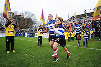 Kahn Fotuali'i of Bath Rugby, mascot in hand, runs out onto the field. Aviva Premiership match, between Bath Rugby and Saracens on December 3, 2016 at the Recreation Ground in Bath, England. Photo by: Patrick Khachfe / Onside Images