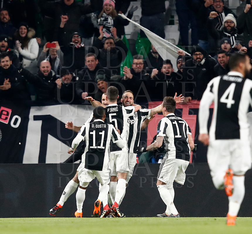 Football Soccer: UEFA Champions League Juventus vs Tottenahm Hotspurs FC Round of 16 1st leg, Allianz Stadium. Turin, Italy, February 13, 2018. <br /> Juventus' Gonzalo Higuain (c) celebrates with his teammates after scoring his second goal in the match during the Uefa Champions League football soccer match between Juventus and Tottenahm Hotspurs FC at Allianz Stadium in Turin, February 13, 2018.<br /> UPDATE IMAGES PRESS/Isabella Bonotto