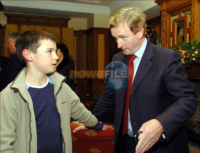 Young Fina Gaeler 11 year old Conor Murphy from Navan asking FG leader Enda Kenny what he is going to do about the release of the Ira Killers that Shol the Garda in Adare, before the Meath by-election convention in the Newgrange Hotel in Navan...Photo Fran Caffrey Newsfile.ie..This Picture has been sent to you by Newsfile Ltd..The Studio,.Millmount Abbey,.Drogheda,.Co. Meath,.Ireland..Tel: +353(0)41-9871240.Fax: +353(0)41-9871260.ISDN: +353(0)41-9871010.www.newsfile.ie..general email: pictures@newsfile.ie