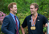 Prince Harry talks with Captain Simon Maxwell, British Royal Marines, Wounded Warriors Games medalist during a reception for U.S. and British wounded warriors at the British Ambassador's Residence in Washington, D.C. on May 7, 2012.  .Credit: Kevin Dietsch / Pool via CNP
