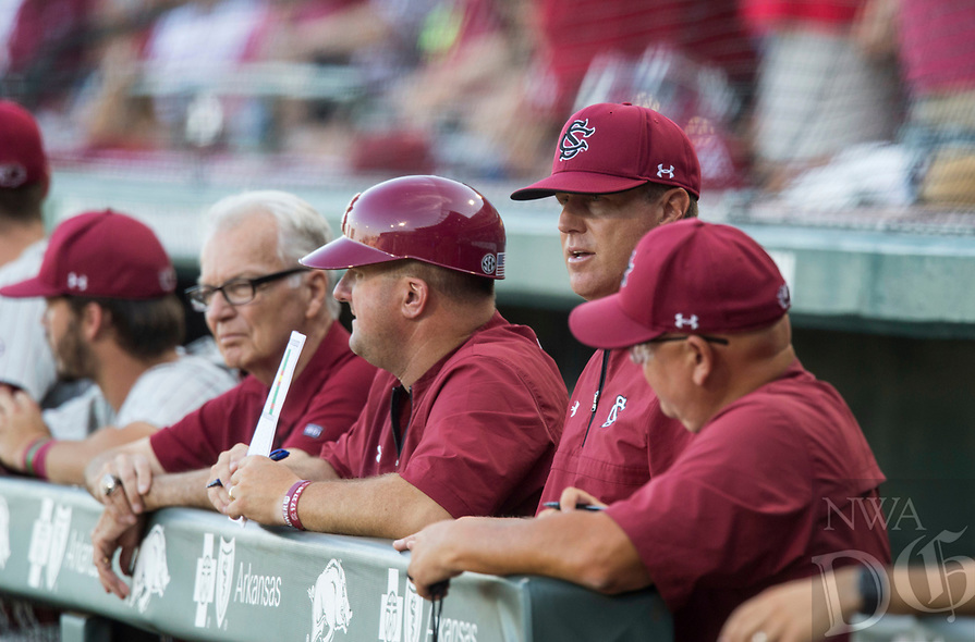 NWA Democrat-Gazette/BEN GOFF @NWABENGOFF<br /> Mark Kingston (second from right), South Carolina coach, watches Saturday, June 9, 2018, during game one of the NCAA Super Regional at Baum Stadium in Fayetteville.